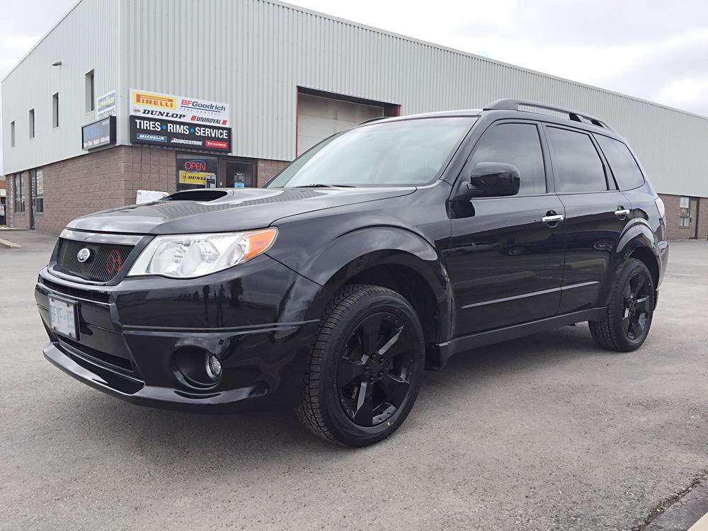 Subaru rim powdercoated in gloss black